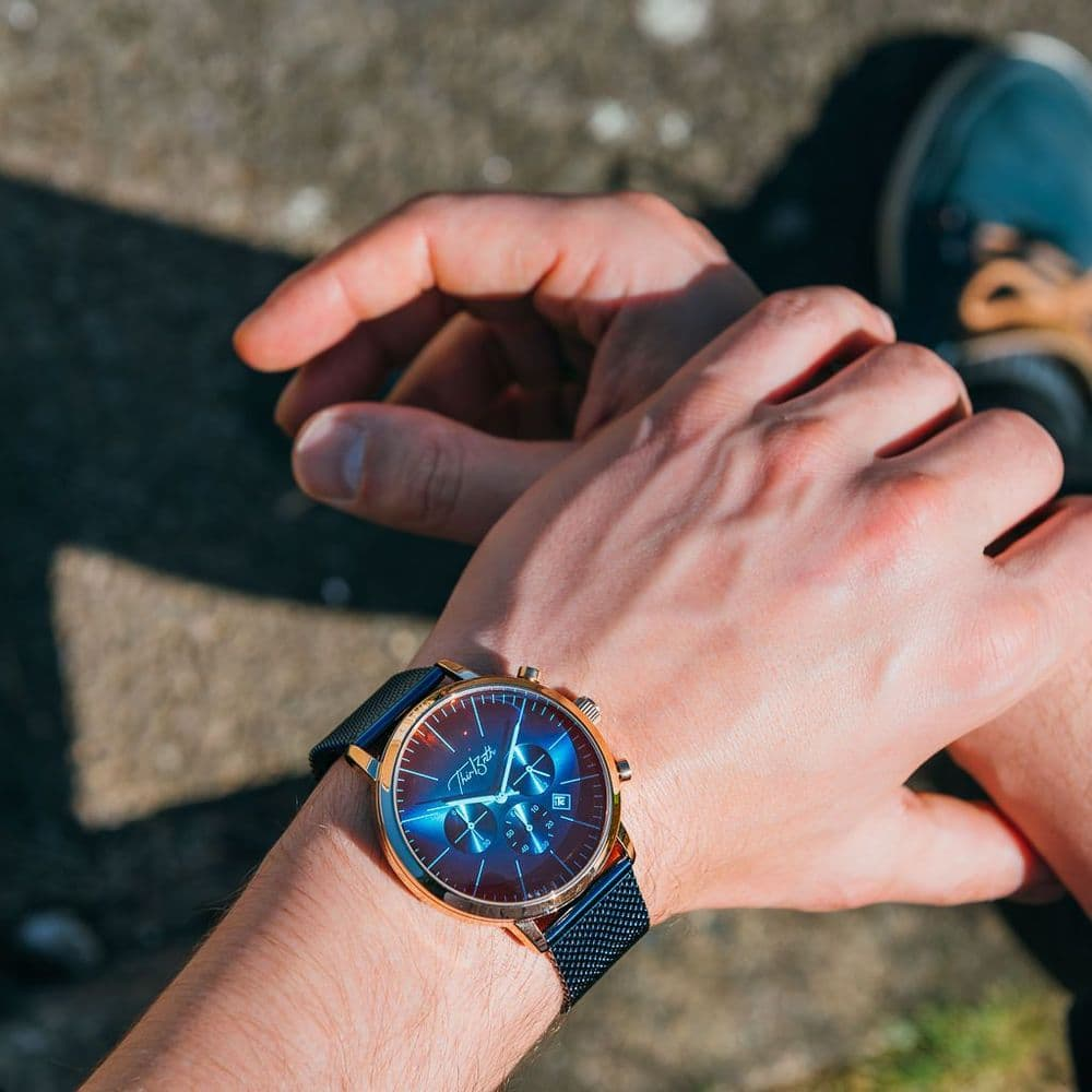 A Thir13nth Iridescence With A Blue Mesh Strap