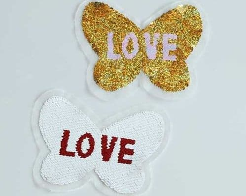 Gold and White Changing color Butterfly Motifs
