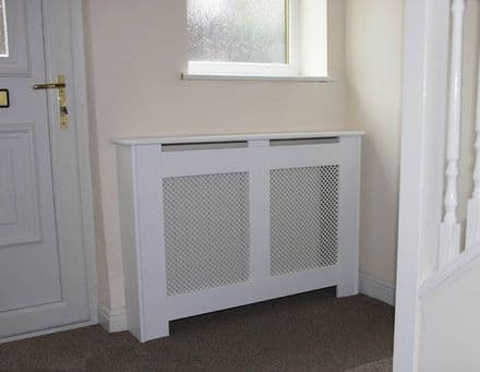 Satin white modern  radiator cover with a pattern design grille.