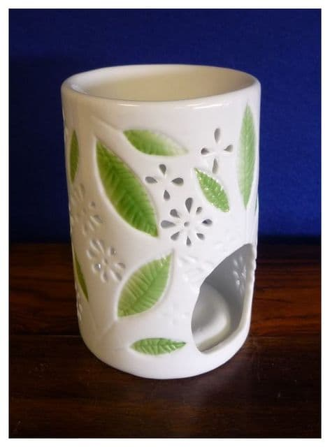 White China Round Oil Burner With a Green Leaf Pattern. . . . .